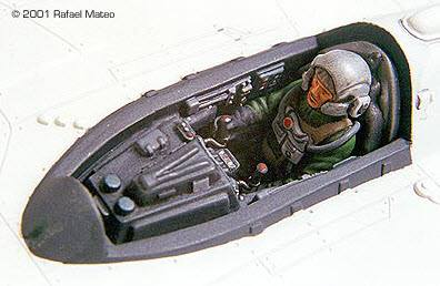 A detailed model of a pilot in the cockpit of a plane.